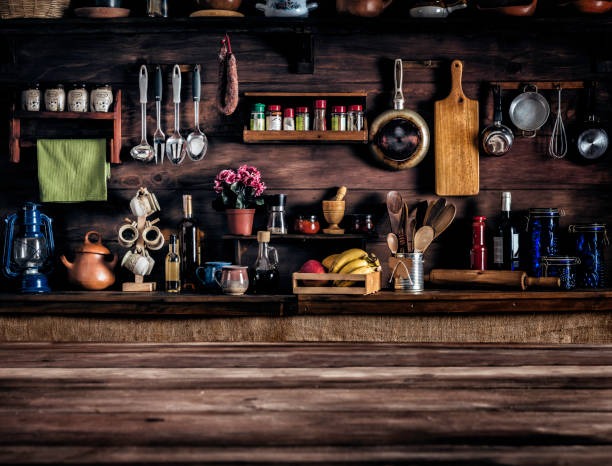 Actual rustic kitchen with utensils for cooking. Table at the foreground with copy space:スマホ壁紙(壁紙.com)