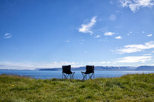 Iceland, two camping chairs on a meadow:スマホ壁紙(壁紙.com)