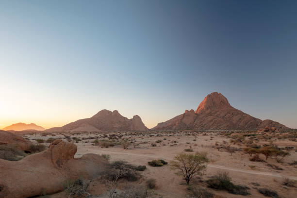 """Spitzkoppe, the 700 million year old mountain also known as """"Matterhorn of Namibia"""" at sunset, Namibia, 2018:スマホ壁紙(壁紙.com)"""