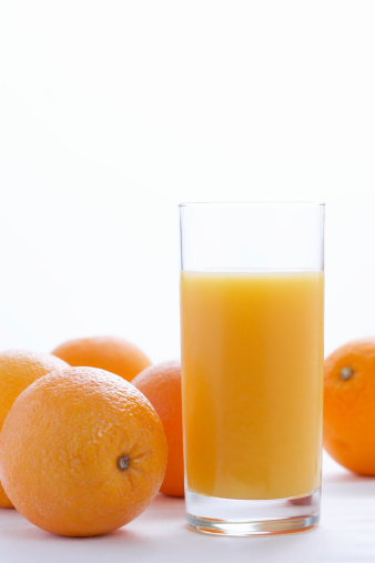 Juice - Drink「Whole oranges by orange juice in glass, close-up」:スマホ壁紙(4)
