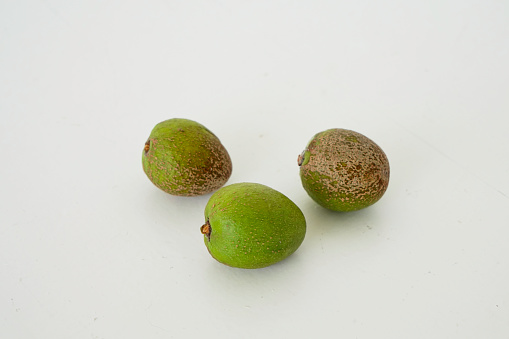 Morocco「Three mature argan nut fruits on a white background」:スマホ壁紙(0)