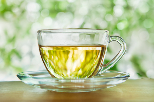Tea「Herbal tea in a glass cup and saucer outdoors」:スマホ壁紙(16)