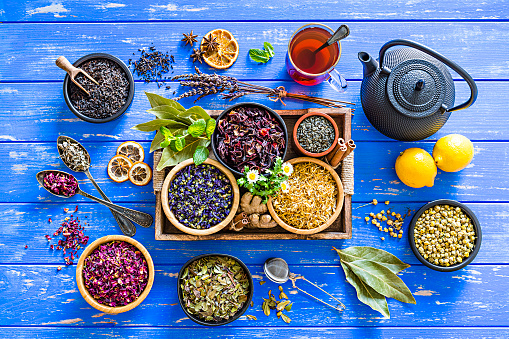 Indian Culture「Herbal tea: various dried tea leaves and flowers shot from above on blue table」:スマホ壁紙(18)