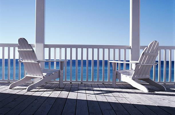 White deck chairs on porch overlooking sea, rear view:スマホ壁紙(壁紙.com)