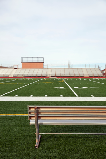 Bench「American football field with bench in foreground and empty bleachers in background」:スマホ壁紙(15)