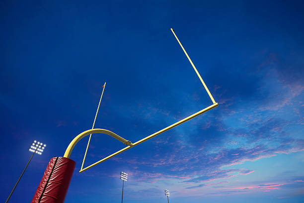 American football goalpost at sunset:スマホ壁紙(壁紙.com)