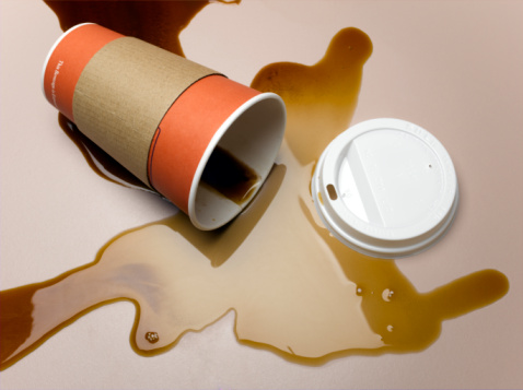 Spilling「Vending cup on side spilling coffee onto surface, elevated view, close-up」:スマホ壁紙(14)