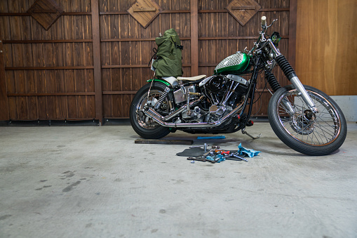 Motorcycle「A custom motorcycle being repaired or maintained in a home garage」:スマホ壁紙(2)