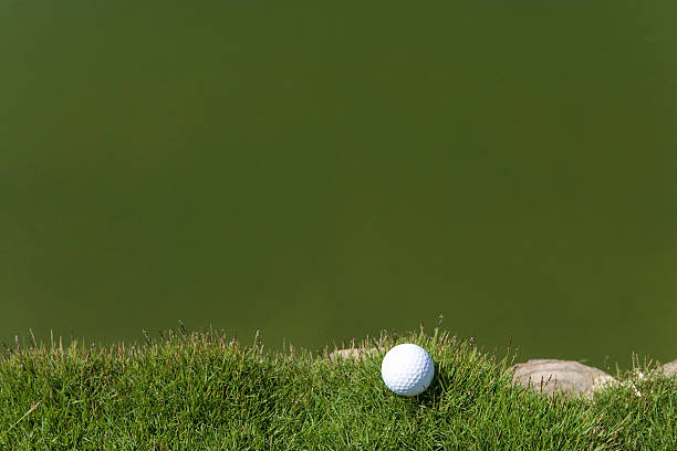 Golf ball on grass, beside the pond, copy space, Saipan, USA :スマホ壁紙(壁紙.com)