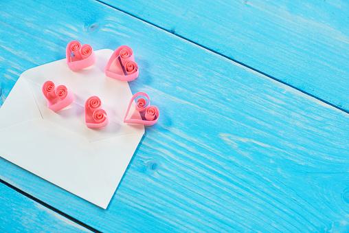 月「Cute hearts on the envelope on the blue board. Debica, Poland」:スマホ壁紙(7)