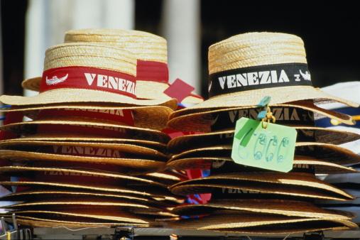 Gift Shop「Italy,Venice,Piazza San Marco, stack of souvenir hats」:スマホ壁紙(2)