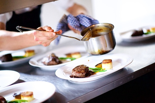 Hand「Steak on a plate being prepared in a Chef's kitchen sauce pouring」:スマホ壁紙(1)