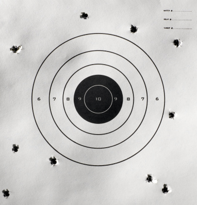 Off Target「Bullet holes around bull's-eye of shooting target」:スマホ壁紙(1)