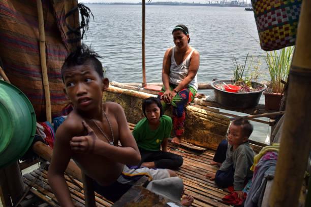 Filipinos Slum Dwellers Risk Rising Waters At Manila's Coast:ニュース(壁紙.com)