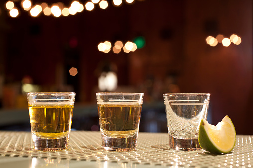 Nightlife「Shots of various types of tequila on bar with lime wedge」:スマホ壁紙(14)