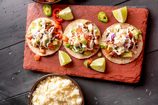 Taco「Pork Carnitas Tacos on a Rustic Slate Ready to be Served with Peppers, Lime, Salsa and Cotija Cheese」:スマホ壁紙(11)