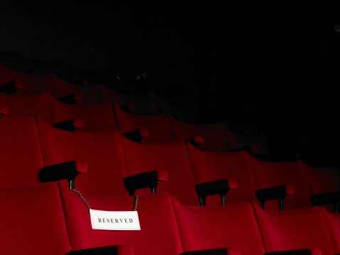 Reserved Sign「Reserved sign on empty cinema seat」:スマホ壁紙(8)