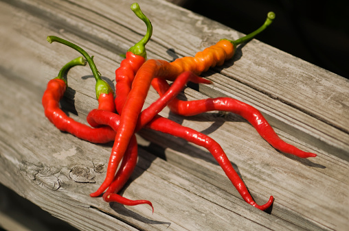 Cayenne Pepper「Freshly Picked Cayenne Peppers on Wooden Surface」:スマホ壁紙(17)