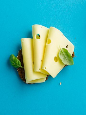Cheese「Brown bread with cheese and basil leaf on blue background」:スマホ壁紙(13)