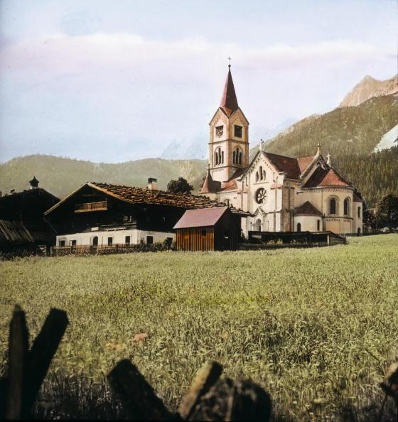 Dachstein Mountains「The Protestant parish church in Ramsau and the Dachstein range in the background. Salzkammergut. Hand-colored lantern slide. Around 1910.」:写真・画像(8)[壁紙.com]