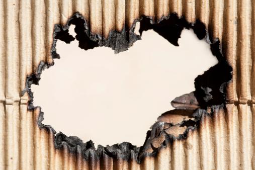 Burnt「Burned hole in cardboard」:スマホ壁紙(0)