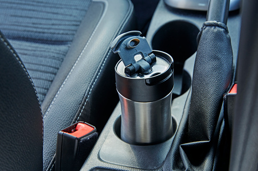 Journey「Metal reusable coffee cup in Coffee cup holder inside car」:スマホ壁紙(11)
