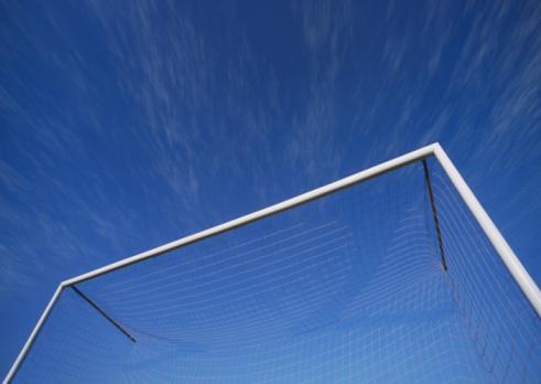 Goal Post「Soccer goal net against blue sky, low angle view」:スマホ壁紙(17)