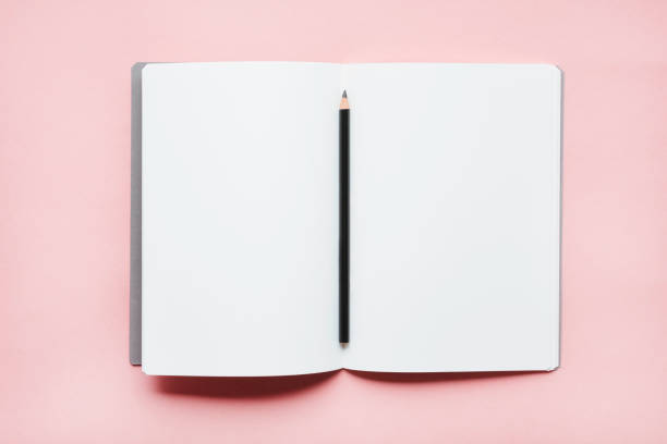 Pencil on open notebook:スマホ壁紙(壁紙.com)