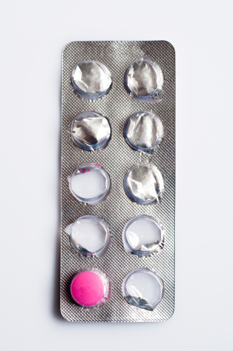 Photography Themes「Blister pack with one pink pill remaining, close-up」:スマホ壁紙(7)