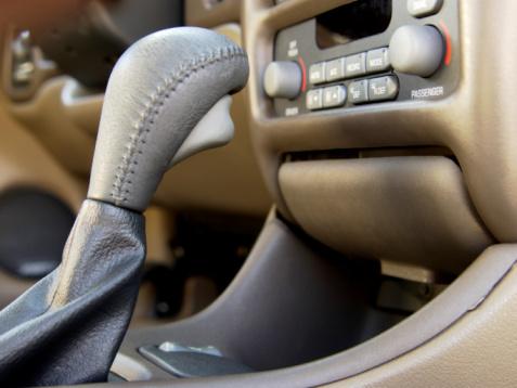 1990-1999「A close-up on a car stick shift and radio」:スマホ壁紙(16)