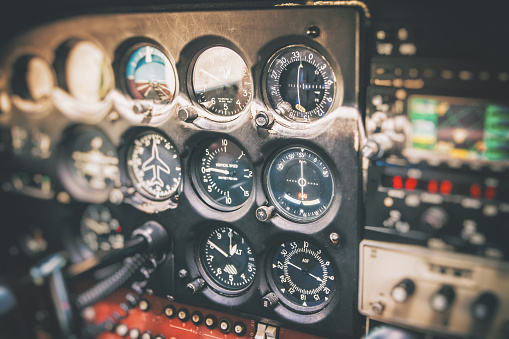 Joystick「Close-up on flight instruments in old small airplane cockpit interior control panel in selective focus」:スマホ壁紙(11)