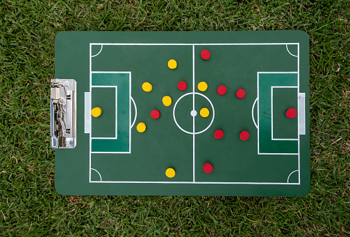 Sports Training「Close-up on a strategy board with the line up at a football field」:スマホ壁紙(1)