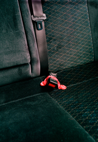 Sexual Issues「Close-up on car backseat with used condom over seatbelt」:スマホ壁紙(1)