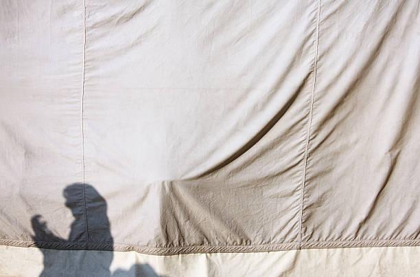 Woman's shadow on tent canvas:スマホ壁紙(壁紙.com)