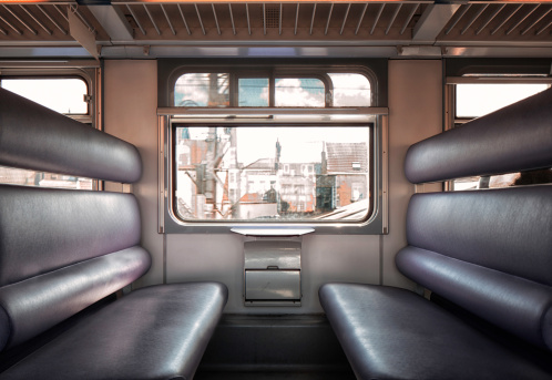 Passenger Cabin「Train cabin interior with empty leather seats」:スマホ壁紙(8)