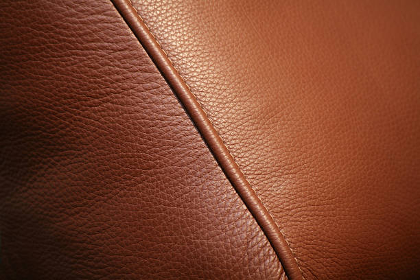 A brown leather texture background:スマホ壁紙(壁紙.com)