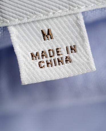 繊維工業「CU of 'Made in China' label on clothing」:スマホ壁紙(19)