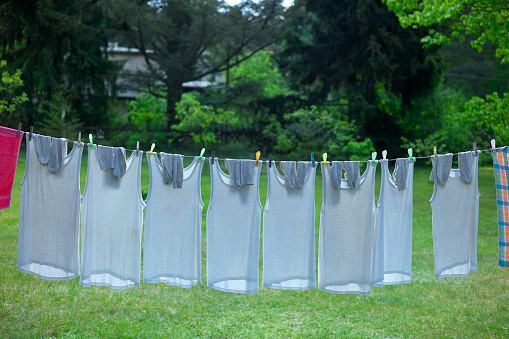 Tank Top「Clothes line filled with identical underwear」:スマホ壁紙(5)