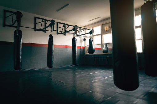 Fighter「Empty gym room with heavy bags」:スマホ壁紙(9)