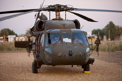 Baghdad「A UH-60L Black Hawk with twin M240G machine guns at the Victory Base Complex in Baghdad, Iraq.」:スマホ壁紙(19)