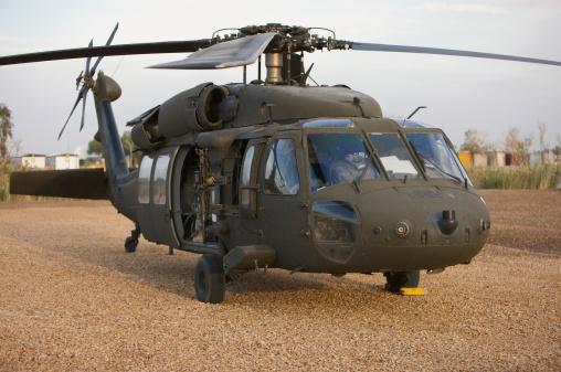 Baghdad「A UH-60L Black Hawk with twin M240G machine guns at the Victory Base Complex in Baghdad, Iraq.」:スマホ壁紙(11)
