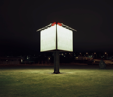 In The Center「Illuminated billboard sign by side of highway at night」:スマホ壁紙(19)