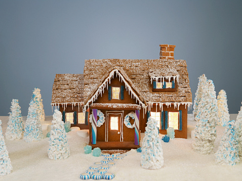Gingerbread Cookie「Illuminated gingerbread house surrounded by miniature trees」:スマホ壁紙(1)