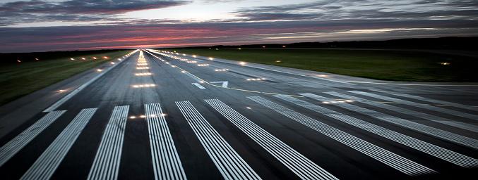 Airport Runway「Illuminated Airplane Runway at Sunset」:スマホ壁紙(0)