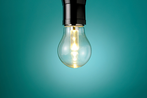 Blue Background「Illuminated LED light bulb against blue background with copy space」:スマホ壁紙(12)