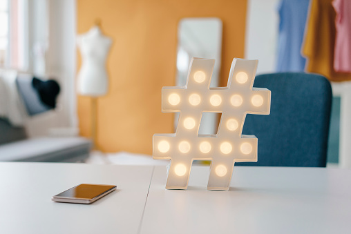 Studio - Workplace「Illuminated hashtag sign on table in fashion studio」:スマホ壁紙(4)