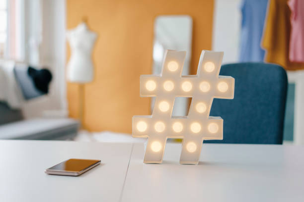 Illuminated hashtag sign on table in fashion studio:スマホ壁紙(壁紙.com)