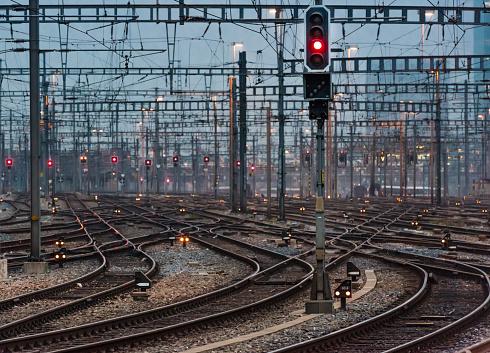 Railway「Illuminated railway track field and switches at twilight」:スマホ壁紙(13)