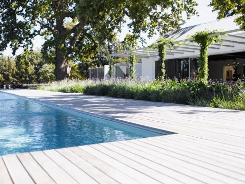 Lawn「Poolside by swimming pool of modern home」:スマホ壁紙(19)