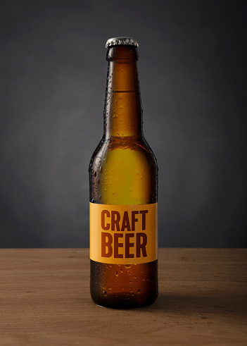 For Sale「cold craft beer bottle with custom made label on the table against black background」:スマホ壁紙(2)